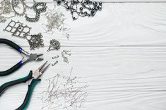 Free Jewelry Findings Handmade Craft Composition With Pliers Beads Embeliдshments On White Wooden Background Stock Photography - 150645552
