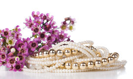 Jewelry and flowers Royalty Free Stock Photo