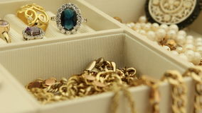 Jewelry Focus shift. Focus shifts over gold jewelry in a jewelry box stock video