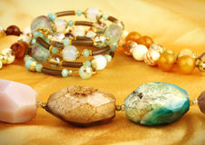 Jewelry gem stones on golden background Royalty Free Stock Image