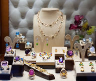 Jewelry with gems at showcase Stock Photos