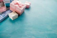 Jewelry gift box feminine present celebration. Jewelry gift boxes assortment with feminine presents inside on blue background. anniversary or birthday holiday Royalty Free Stock Photos