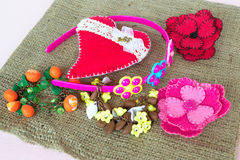 Jewelry for girls, bracelets, hoop, felt brooches and heart Stock Image