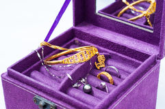 Jewelry. Gold and Platinum jewelry in a purple box Royalty Free Stock Photos