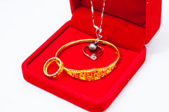 Jewelry. Gold and Platinum jewelry in a red box Stock Photos