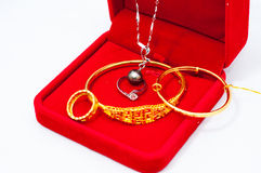 Jewelry. Gold and Platinum jewelry in a red  box Stock Images