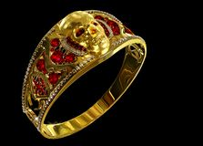 Jewelry gold skull ring with diamond and red ruby gems. Antiques fingers ring from pirate treasure or hoard may be magic vampire artifact. Luxury bijouterie Royalty Free Stock Images