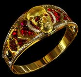 Jewelry gold skull ring with diamond and red ruby gems. Antiques fingers ring from pirate treasure or hoard may be magic vampire artifact. Luxury bijouterie Stock Photo