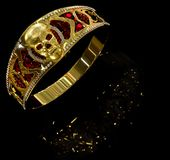 Jewelry gold skull ring with diamond and red ruby gems. Jewelry gold skull ring with diamond and red gems. Antiques fingers ring from pirate treasure or hoard Stock Images