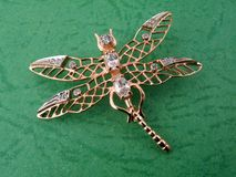 Jewelry golden dragonfly Royalty Free Stock Image