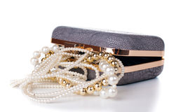 Jewelry in handbag Stock Images