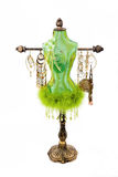 Jewelry holder. Antique jewelry holder with ostrich feathers in the shape of a tailor mannequin I think is called dressmaker dummy Stock Photos