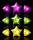 Jewelry icons of stars and arrows. Violet, green, yellow Stock Image