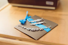 Jewelry on Invitation Card Stock Photos