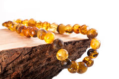 Jewelry made of amber on a white background Royalty Free Stock Image