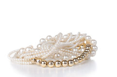 Jewelry made ​​of gold and white pearls Stock Photo