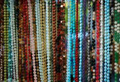 Jewelry made of natural stones in a street shop royalty free stock photography