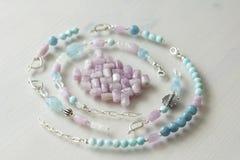 Free Jewelry Made Of Natural Stones And Silver. Aquamarine, Larimar, Kunzite, Moonstone. Handmade. Asymmetric Jewelry. Asymmetry. Royalty Free Stock Photo - 134127355