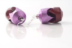 Earrings in recycled coffee pods Royalty Free Stock Images