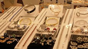 Jewelry made of silver on the shop window. Various silver rings, chains, precious stones, pendants and other beautiful products made of precious materials stock video