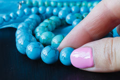 Jewelry made of turquoise on a woman`s hand Royalty Free Stock Photography