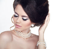 Jewelry and Makeup. Fashion portrait of beautiful woman with pea Stock Photos