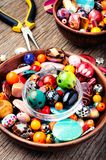 Colorful beads on a wooden surface royalty free stock photo