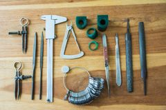 Jewelry Making Tools. On wooden table royalty free stock photos