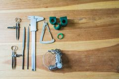 Jewelry Making Tools. On wooden table royalty free stock image
