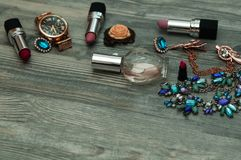 Jewelry on a marble background. Top view, fashionable male and female personal items with space on a dark wooden background stock image