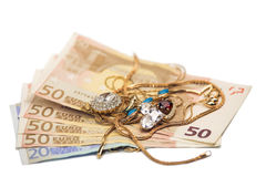 Jewelry and money Stock Images