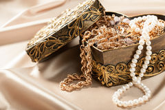Jewelry and other decorations in decorative box heart shape Royalty Free Stock Photos