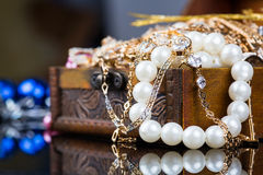 Jewelry, pearl jewelry box. Old wooden open chest with golden jewelry Royalty Free Stock Photography