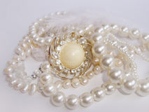 Jewelry, pearl necklace and brooch Royalty Free Stock Images