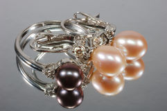 Jewelry with pearls. Set of white gold jewelry with diamonds and pearls Stock Photo