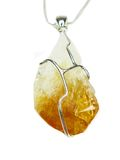 Jewelry pendant with bright citrine crystal Stock Image