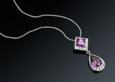 Jewelry pendant with chain and gems on darck background Stock Photography
