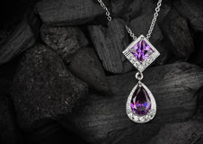 Jewelry pendant witht gem  amethyst on dark coal background, cop Royalty Free Stock Images