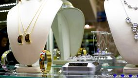 Jewelry with stones and rhinestones on the shelf gems in jewelry stock video