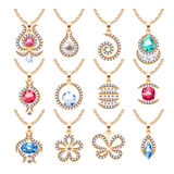 Jewelry pendants set. Golden chains with gemstones. Royalty Free Stock Images