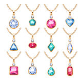 Jewelry pendants set. Golden chains with gemstones. Royalty Free Stock Photos