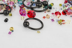 Jewelry for piercing and natural gemstones. Royalty Free Stock Images