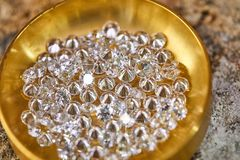 Jewelry production. Diamonds in the plate royalty free stock images