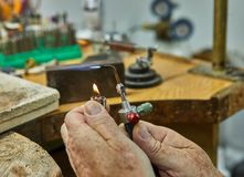Jewelry production. The jeweler makes a gold ring royalty free stock photos