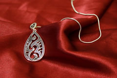Jewelry on red silk Royalty Free Stock Images