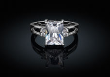 Jewelry ring with big square clean diamond on black background w Stock Photography