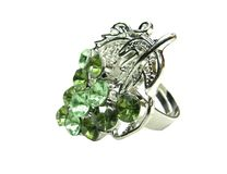 Jewelry ring with bright green crystals Stock Image