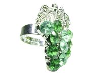 Jewelry ring with bright green crystals Stock Images