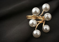 Jewelry ring with pearl on black cloth, soft focus Royalty Free Stock Photo