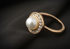 Jewelry ring with pearl on black cloth, soft focus Stock Photo